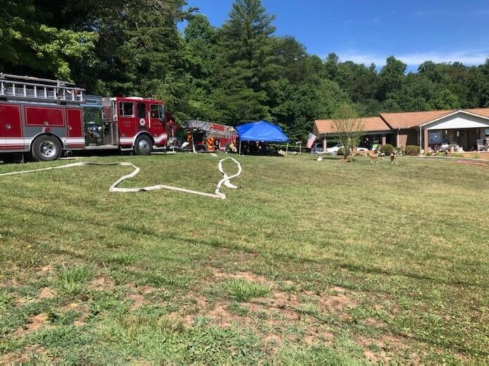 Four people have died after a possible explosion Wednesday morning at a home in Lenoir. Photo courtesy Dave Faherty, WSOCTV